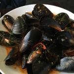 Chilli mussels with sauce poured over and in too flat a bowl so cool