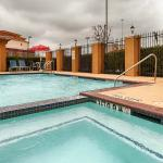 Relax in our outdoor hot tub or swimming pool after a long day.