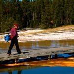 Anita crosses boardwalk of Upper Basin