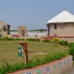Bhunga with green lawn