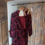 Vintage dressing gowns in each room, for the use of guests.
