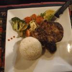 carribean jerk pork chop with coconut rice and veggies