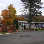 Hotel grounds surrounded by beautiful fall colors; seating area is at left