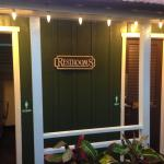 Themed outbuilding restrooms.