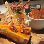 Sharing dessert platter: cheesecake, tiramisu, panna cotta, creme brulee