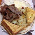 2 eggs, gyro meat with excellent cucumber sauce, home fries and toast. A lot of delicious food.