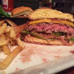 Triple Prime Applewood smoked bacon cheddar burger whoray done rare