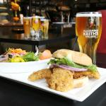 haddock fish sandwich with a pint of beer