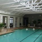 Indoor swimming pool in the spa complex and the old farm buildings converted into 5 star rooms