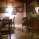 Historic photos on wall of comfortable dining area