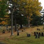 Spooky tombstones amidst the fall foliage