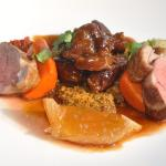 Lamb cooked two ways, pan roasted loin lamb tagine cous cous, rose petal harrisa  and aubergine
