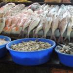 Buy fresh fish at the market and have a nearby restaurant cook it for you!