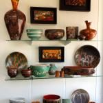 Selection of Ed Barnes wall pieces and Julie Covington pottery