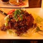 Pad Tamarind (Deep fried meat with lettuce, garnish and fried with shallot in tamarind sauce)