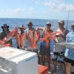 A group of happy guests with their catch!