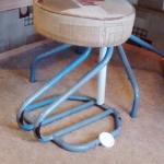 rusty stool with makeshift repair