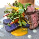 Bavette steak, smoked blue potatoes, green beans, radish, pickled vegetables, garlic pesto.
