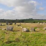 view of stone circle from end of hedged laneway.