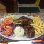 lamb chops with rice fries and salad