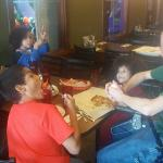 My husband, kids and brother enjoying our meals!