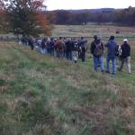 The group trekking down Cemetery Hill headed to Culps Hill