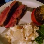 Chateaubriand with au gratin potatoes and stuffed tomato