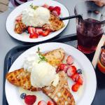 Waffles with white chocolate ice cream and fresh berries