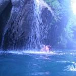 Float under cascading crystal clear spring water
