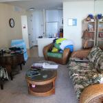 305 living area.  Kitchen to the back, door to bedroom off to the left.