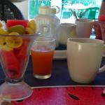 Fresh fruit salad with juice and coffee.