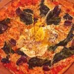 The Florentina. Egg, spinach, kalamata olives and melted mozzarella sit quietly atop a thin crus