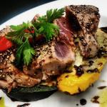 seared ahi tuna/ assorted cracked peppercorns/ grilled seasonal vegetables/ honey-balsamic gastr
