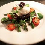 poached egg, on black pudding with grilled asparagus and