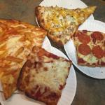 Delicious gourmet pizza and Sicilian slices