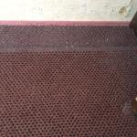 Accumulated dirt all over the room. The edges of the rugs have never been cleaned!