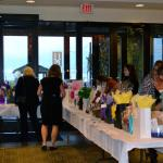Guests bidding on silent auction items