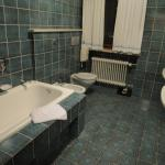 Tiled bathroom with tub