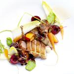 Pan fried quail with broadbeans, cherries, endive, cumin carrots and sherry jus