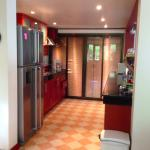open part of kitchen, cooktop, fridge and microwave well equiped