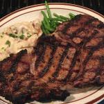 Specially Seasoned, Hand Carved, Housed Aged, Fire Grilled 14oz Ribeye