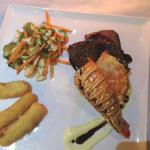 lobster tail with beef tenderloin, vegetables and potato fingers