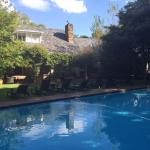 View of pool and main house from thatched cottage