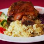 Rosemary flavoured roasted leg of duckservedwith onion crushed potato and steamed red cabbage