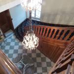 View from the top of the stairs down to the entrance hall.