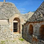 The 700 year old trulli farmhouse in the centre of a vineyard