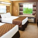 Traditional 2 Queen Beds Room with free buffet breakfast,refrigerator, and microwave
