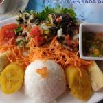 Grilled mahi mahi (dorade) with rice, veggies, plantains, and steamed breadfruit. Tasty!