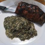 Sirloin with creamed spinach before I attacked it.
