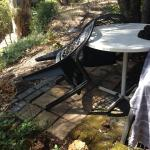 The outdoor table & chairs with uneven paving